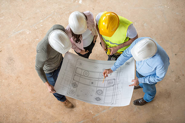 architects looking at blueprints - civil engineer stock photos and pictures