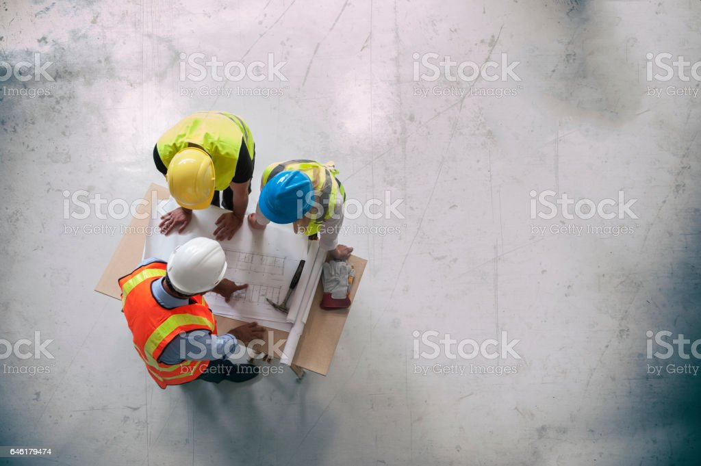 Architects looking at blueprints stock photo