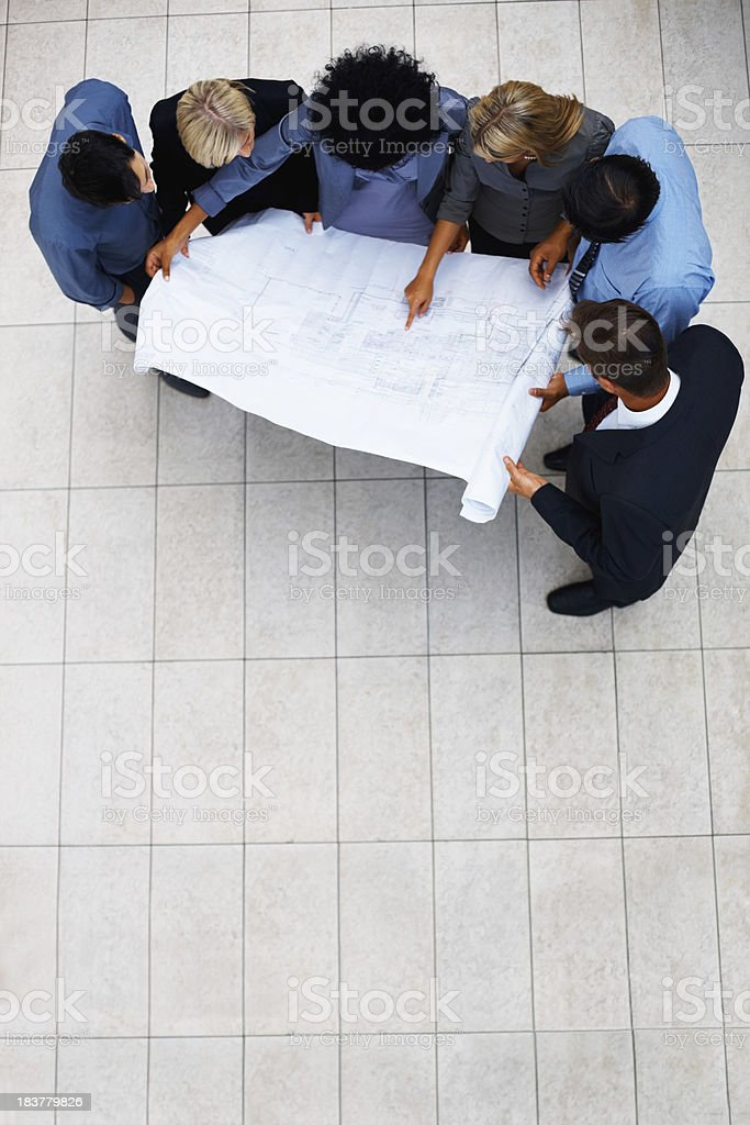 Architects looking at plan together royalty-free stock photo