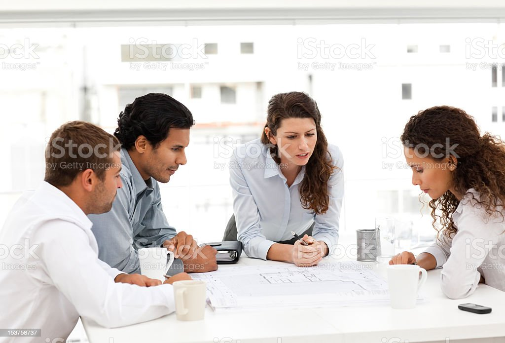Architects looking at plans together royalty-free stock photo