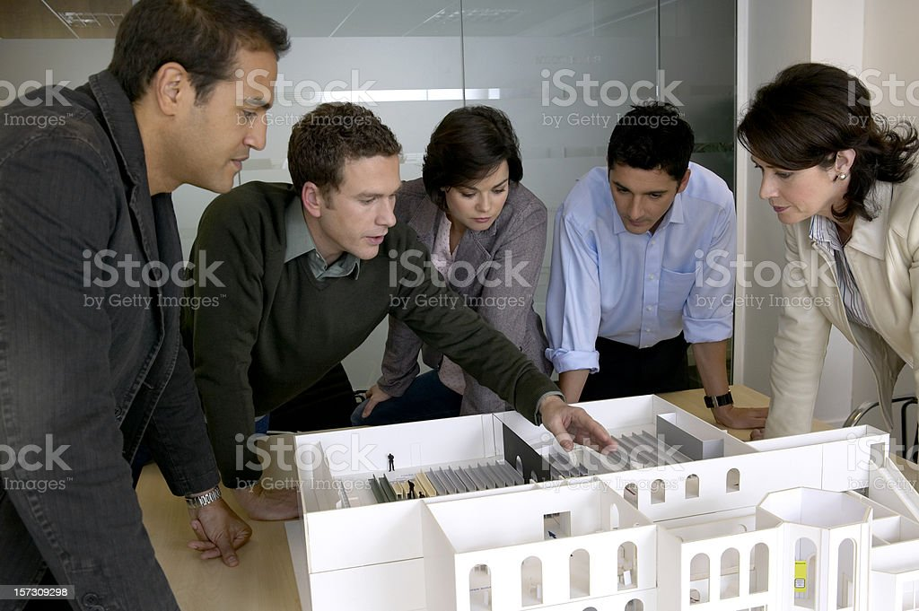 Architects looking over design. N.B* Mocked up model royalty-free stock photo