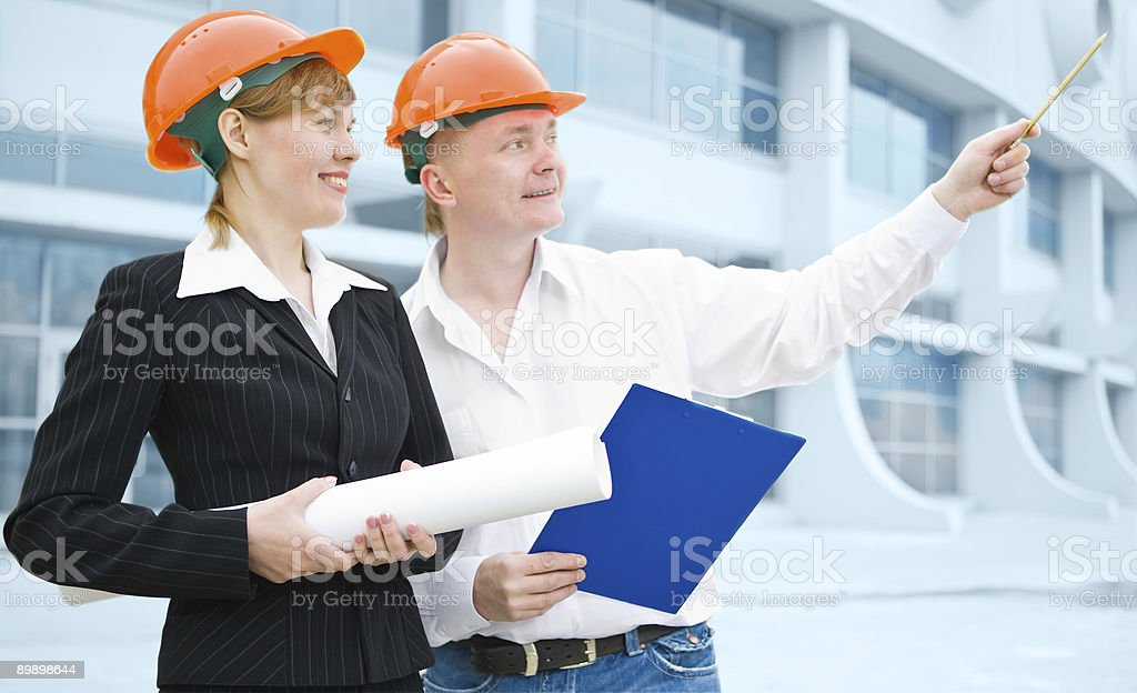 architects man and woman  protective helmet royalty-free stock photo