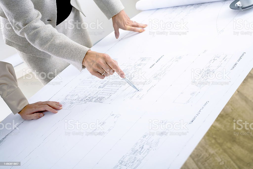 Architects planning on blueprint - Royalty-free Adults Only Stock Photo