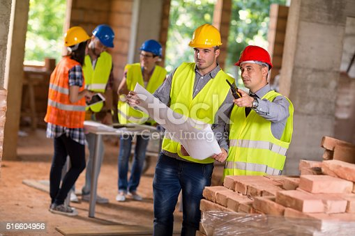 516607254istockphoto Architects planning together future building 516604956