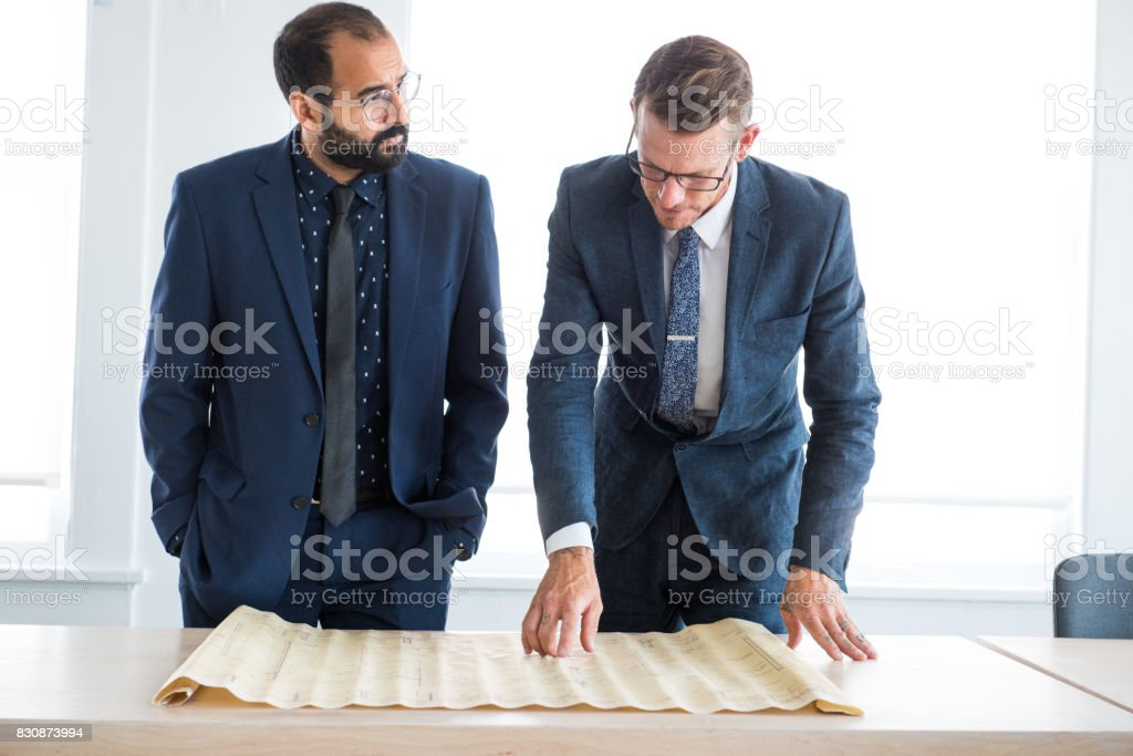 Architects Review the Blueprint Plans stock photo