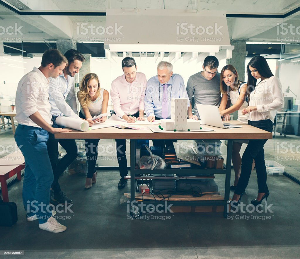 Architects reviewing architectural model in the office. royalty-free stock photo