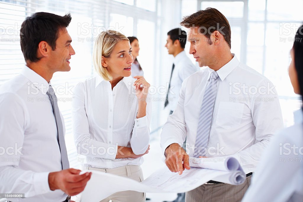 Architects reviewing blueprints royalty-free stock photo