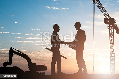istock Architects Shaking Hands Outdoors 1050851958