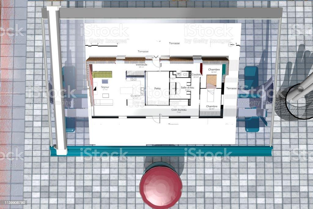 Table d\'architecte en verre avec plan d\'architecture et la...