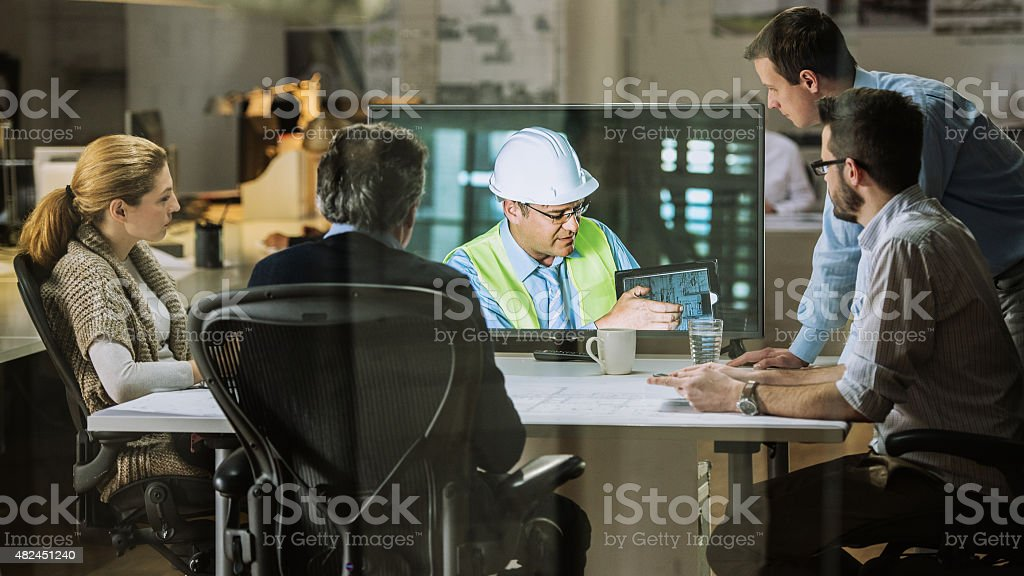 Architects team having video conference stock photo
