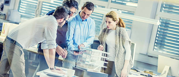 Architects team working on project plan stock photo