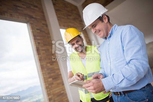 istock Architects working at a construction site 473247660