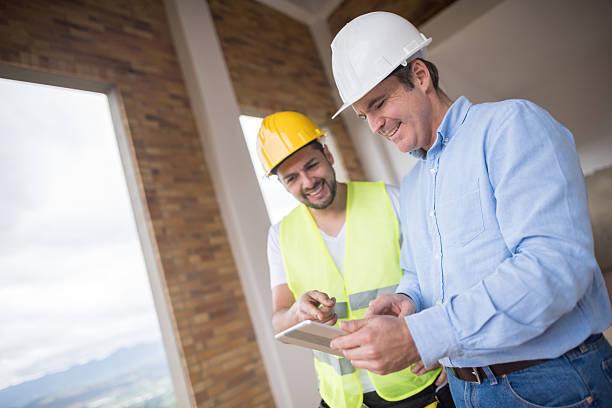 architects working at a construction site - civil engineer stock photos and pictures