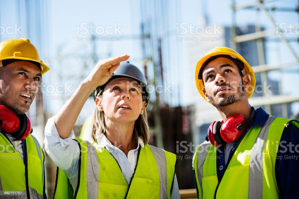 Architects working at construction site stock photo