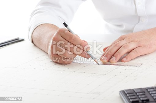 istock Architects working on blueprint, real estate project. Architect workplace - architectural project, blueprints, ruler, calculator, laptop and divider compass. Construction concept. Engineering tools. 1096993288