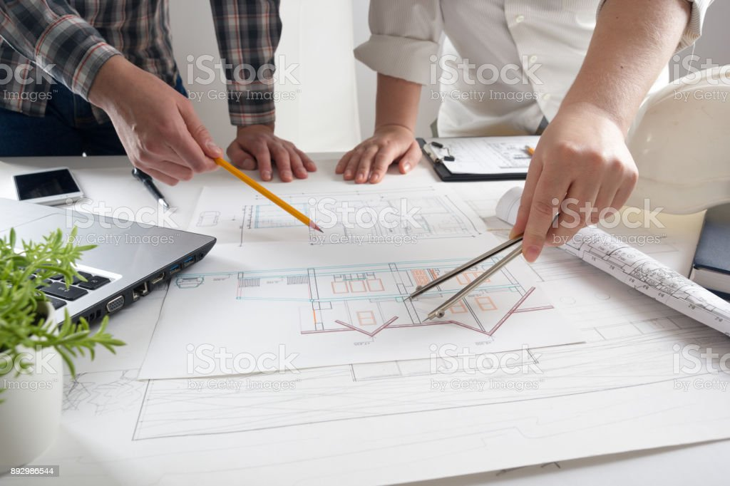 Architects working on blueprint real estate project architect architect architectural model blueprint construction site desk malvernweather Image collections