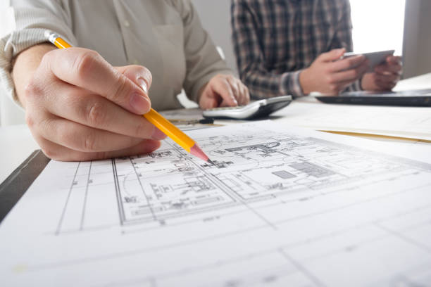 Architects working on blueprint, real estate project. Architect workplace - architectural project, blueprints, ruler, calculator, laptop and divider compass. Construction concept. Engineering tools Architects working on blueprint. Architects workplace - architectural project, blueprints, ruler, calculator, laptop and divider compass. Construction concept. Engineering tools. real estate sign stock pictures, royalty-free photos & images
