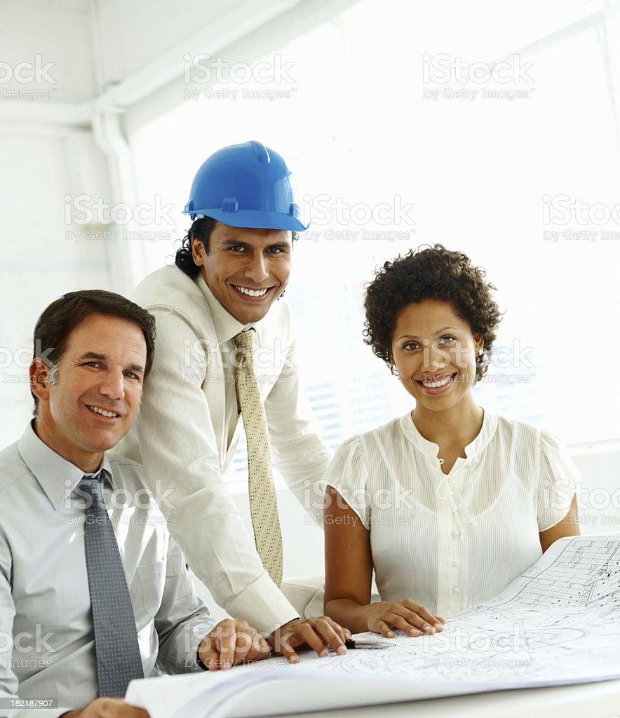 Architects working on blueprints royalty-free stock photo