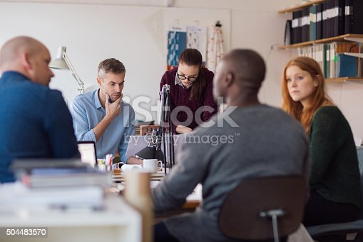 istock Architects working on project 504483570