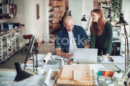 istock Architects working on project 610971232