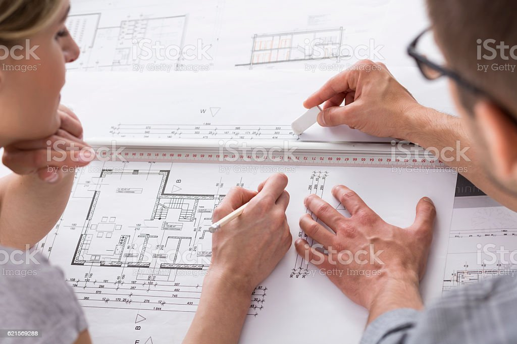 Architects working on some professional drawing photo libre de droits