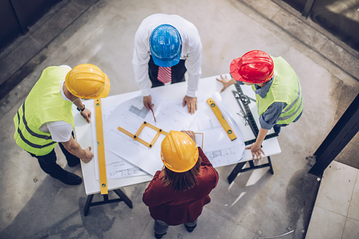 istock Architects working together at construction site 936346930