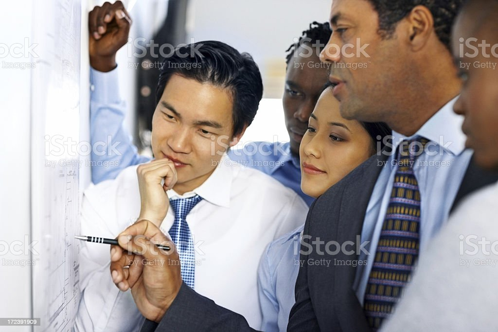 Architects working together on new building plans royalty-free stock photo
