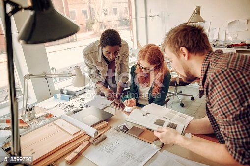 istock Architects working together 518599720