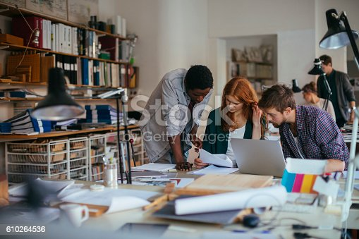 istock Architects working together 610264536