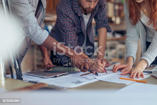 istock Architects working together 625060360