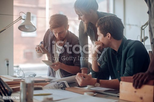istock Architects working together 625383786