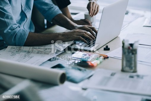 625937646 istock photo Architects working together 625937584