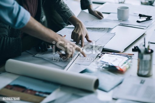 istock Architects working together 625937646