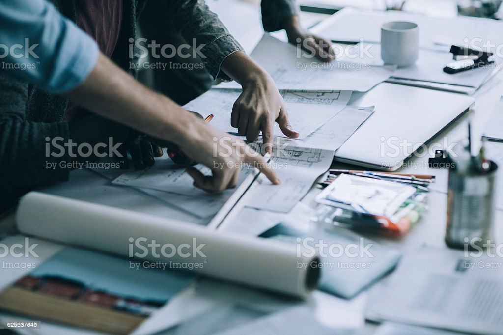 Architects working together bildbanksfoto