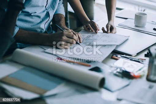 Close up of a coworkers working on a project