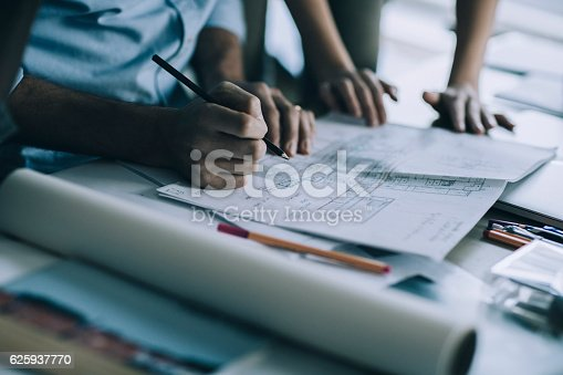 istock Architects working together 625937770