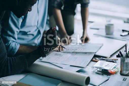 istock Architects working together 625939928