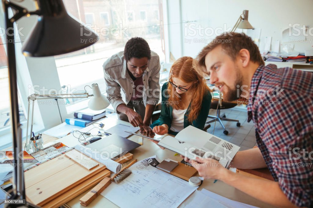 Close up of a group of architects working