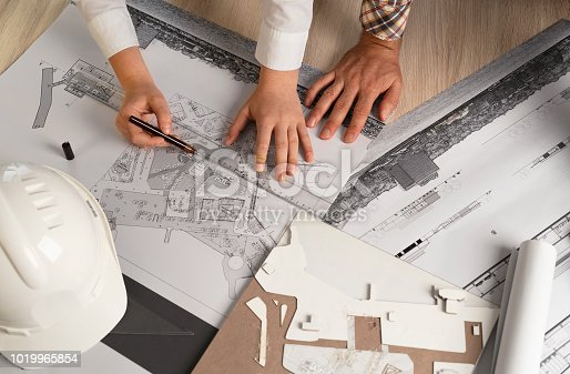 832105172 istock photo Architects Working with Blueprints 1019965854