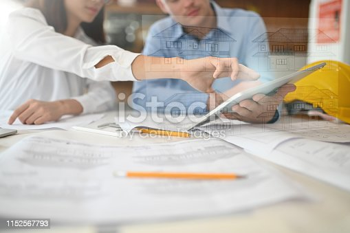 534196421istockphoto Architects working with digital tablet computer ar visual house plan. 1152567793