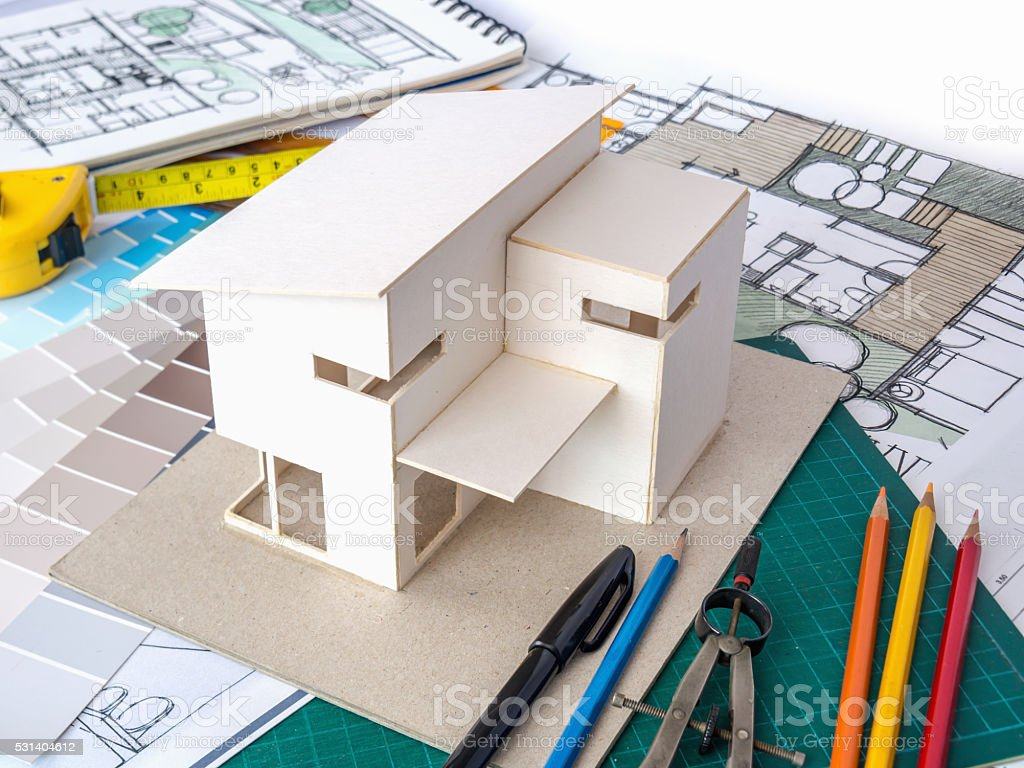 Architects workspace with house model blueprints home renovation architects workspace with house model blueprints home renovation concept royalty free stock photo ccuart Gallery