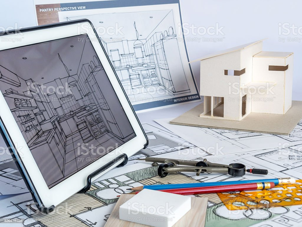 Architects workspace with tablet house model drawing housing architects workspace with tablet house model drawing housing development business royalty free malvernweather Images