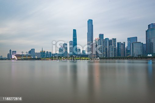 Architectural and urban skyline scenery on both sides of the Pearl River in Guangzhou, China, at dusk in the evening