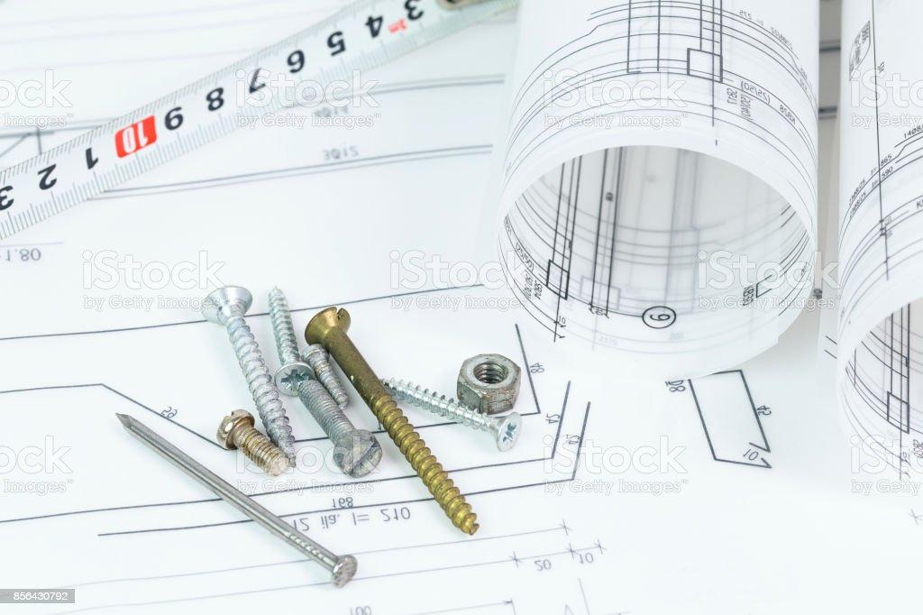architectural background with plan, blueprint roll and drawing compass (mimari çizim ve pergel yakın çekim) stock photo