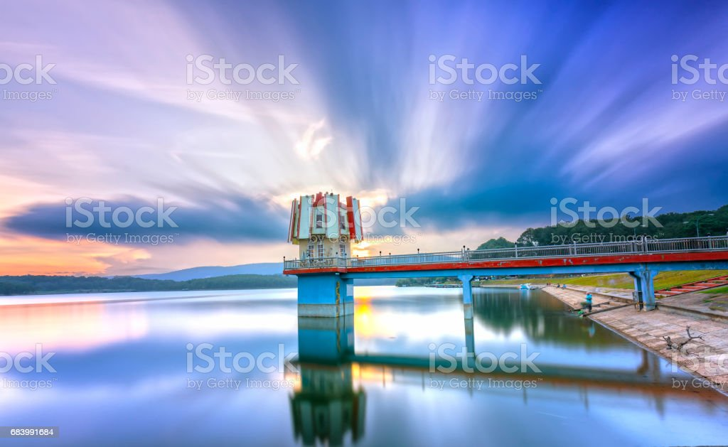 Architectural beauty sunset with clouds hydrogen towers leads to center fanciful stock photo