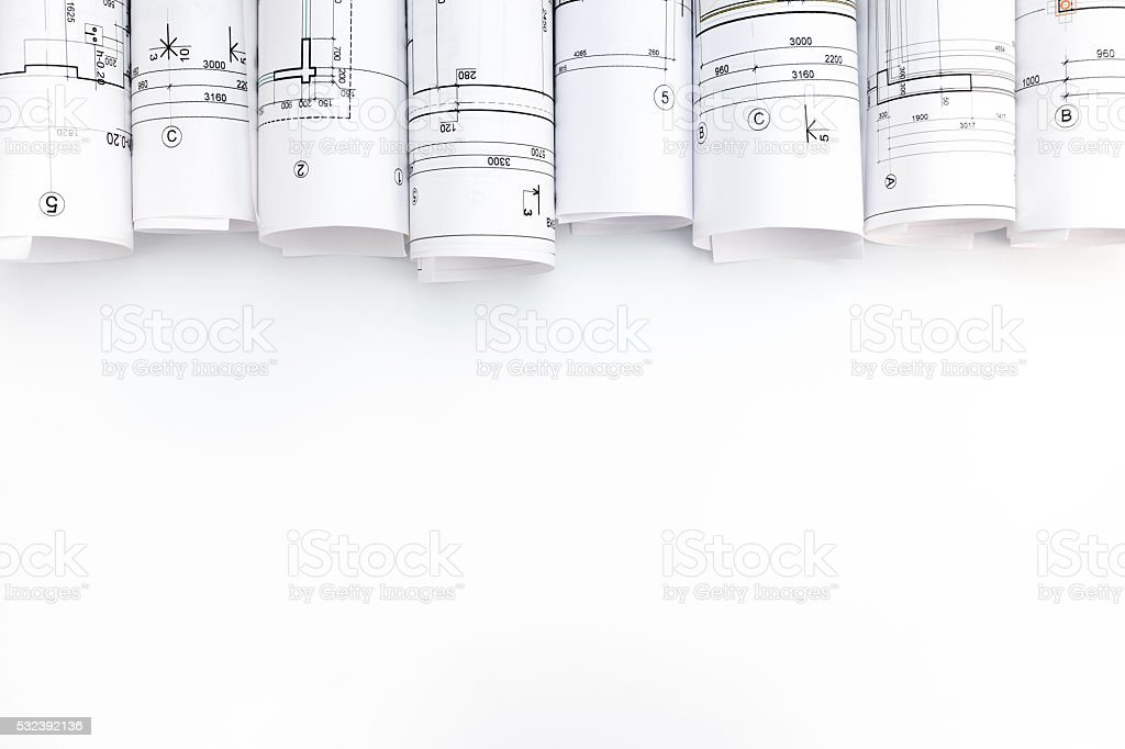 architectural blueprint rolls on white background stock photo