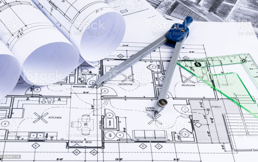Architectural blueprints and blueprint rolls and a drawing architectural blueprints and blueprint rolls and a drawing instruments on the worktable drawing compass malvernweather Image collections