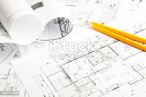 508818208 istock photo Architectural blueprints and blueprint rolls 532774509
