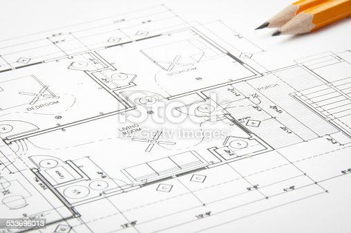 536856115istockphoto Architectural blueprints and blueprint rolls with drawing instruments 533696013