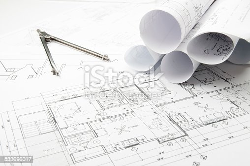 508818208 istock photo Architectural blueprints and blueprint rolls with drawing instruments 533696017